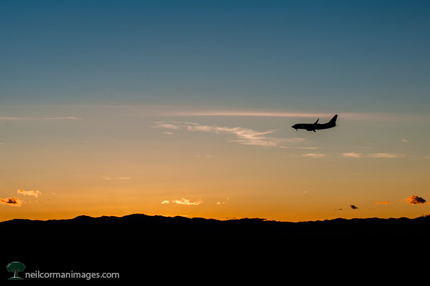 Airplane at Sunset over Rocky Mountains