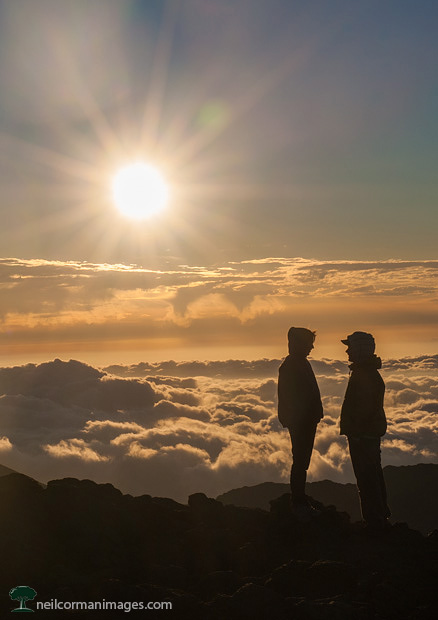 Couple at the top of Haleakala for sunrise in Hawaii