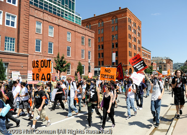 Protesters march towards the Pepsi Center