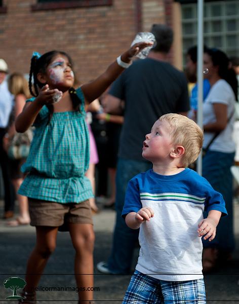 Kids Playing at the Bubble Machine