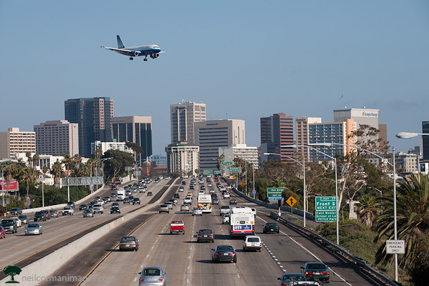 Airplane Arriving at San Diego with Skyline