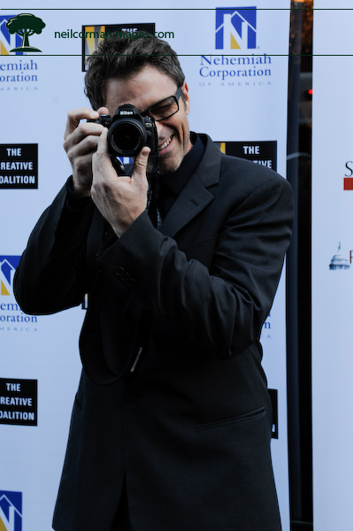 Actor Tim Daly with a Nikon camera